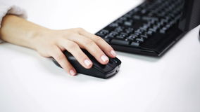 Woman hands typing on computer keyboard at office stock video footage