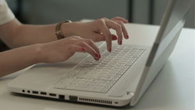 Woman hands typing on computer keyboard. People stock video footage