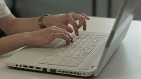 Woman hands typing on computer keyboard. Professional shot in 4K resolution. You can use it e.g. in your commercial video, business, presentation, broadcast royalty free stock photography