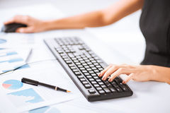 Woman hands typing on keyboard. Picture of woman hands typing on keyboard Royalty Free Stock Images