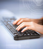 Woman hands typing on keyboard Stock Photography