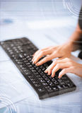 Woman hands typing on keyboard Royalty Free Stock Images