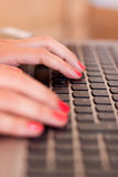 Woman hands typing Royalty Free Stock Photos