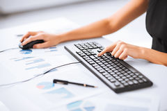 Woman hands typing on keyboard Stock Image