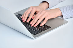 Woman hands typing laptop Stock Photos