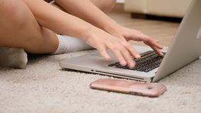 Woman hands typing on the laptop keyboard. Close up dolly of woman hands typing on the laptop keyboard stock footage