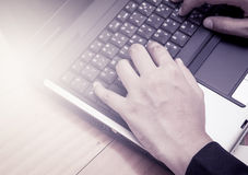 Woman hands typing on laptop keyboard Stock Photo