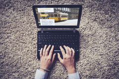Woman hands typing on a laptop. Traveling blog on the screen Royalty Free Stock Image