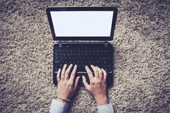 Woman hands typing on a laptop, vintage style. Stock Image