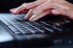 Woman hands typing on laptop. Working Royalty Free Stock Photo