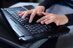 Woman hands typing on laptop. Working Stock Photo
