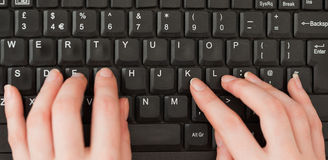 Woman hands typing on a screen Stock Image
