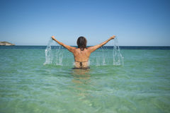 Woman Hands Up Ocean Stock Photo