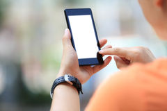 Woman hands use smart phone in city. Closeup of young woman hands use smart phone in city royalty free stock image