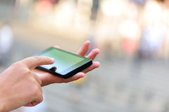 Woman hands use smart phone outdoor Stock Photo