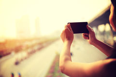 Woman hands use smart phone outdoor. Woman hands use smart phone in modern city stock photo