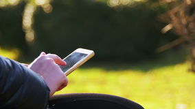 Woman hands use smartphone and browse face book social network site, typing message stock video