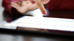 Woman hands using digital tablet. Close up stock video