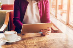 Woman hands using and holding  computer tablet in coffee shop Stock Photos