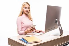 Woman hands using smart phone. business woman hands busy using cell phone at office desk stock photography