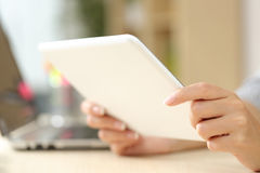 Woman hands using a tablet on a desk Stock Image