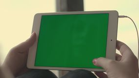 Woman hands using at tablet with green screen and scrolling pages. Woman using at tablet computer with green screen in home. Female scrolling pages. Close up stock video