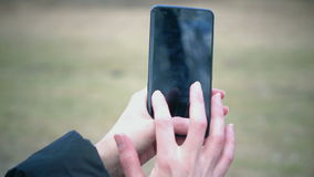 Woman (only hands) using touch screen on the phone stock footage