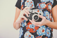 Woman hands with vintage photo camera Royalty Free Stock Photo