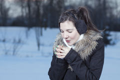 Woman hands warm breath Stock Photo