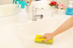 Woman hands cleaning washroom. Woman hands wash the washbowl Stock Photo