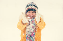 Woman Hands wearing gloves shaking snow outdoor Royalty Free Stock Photo