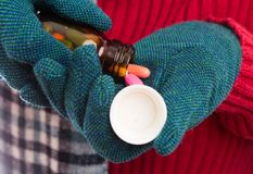 Woman hands wearing textile gloves pouring meds Stock Images