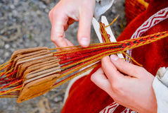 Woman hands weaving traditional belt Stock Images
