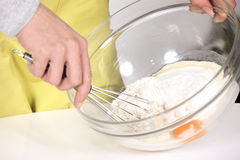 Woman whisking batter Stock Images