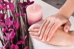 Free Woman Hands With Ombre French Nails And Purple Flower With Aromatic Candle In Spa Stock Photography - 127056212