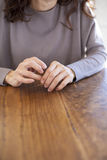 Woman hands on wooden table stock photos