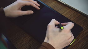 Woman hands working on graphic tablet. stock video