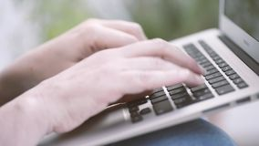 Woman hands working with a laptop. stock footage