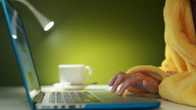 Woman hands working with a laptop stock footage