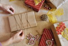 Woman hands wrapping christmas gift box Royalty Free Stock Image