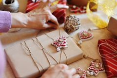 Woman hands wrapping christmas gift pack Royalty Free Stock Photo