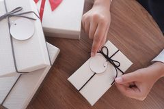 Woman hands wrapping gift box, unwrap or open present royalty free stock photography