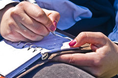 Woman hands write notes. Woman hands closeup while writing notes Royalty Free Stock Photo