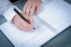 Woman hands writing plans with a pen at notebook Royalty Free Stock Image