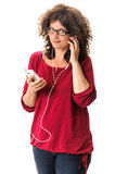 Woman with handsfree earphones and smartphone Royalty Free Stock Photo