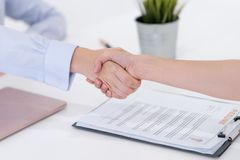 Handshake after accepted in a job interview. Woman handshake after accepted in a job interview stock photography