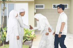 Happy Indonesian young family Eid al-fitr celebration at home