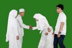 Happy Indonesian young family Eid al-fitr celebration in studio