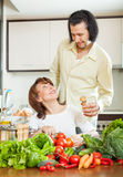 Woman and handsome husband cooking with  vegetables Royalty Free Stock Photography