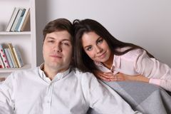 Woman and handsome man pose together Stock Image